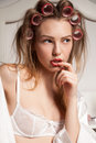 Fashion photo of beautiful blond woman with curler in the hair beauty hairstyle girl Royalty Free Stock Image