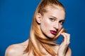 Fashion photo of beautiful model with ponytail.