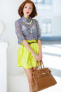 Fashion photo of beautiful young woman with bag. Royalty Free Stock Photo