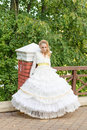 Fashion photo of a young girl in a beautiful white dress Royalty Free Stock Photo