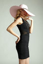 Fashion photo of young magnificent woman in hat girl posing studio blonde Royalty Free Stock Photos