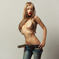 Fashion photo young sensual woman jeans Royalty Free Stock Image