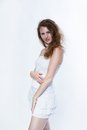 Fashion photo of a young woman with curly hair wearing white dress Royalty Free Stock Photos