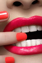 Fashion pink lips make up and nails polish close of woman s with hot lipstick makeup beauty macro sexy with bright magenta color Royalty Free Stock Image