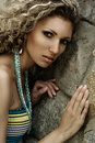 Fashion portrait against stone wall Royalty Free Stock Photo