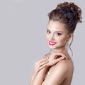 Fashion portrait of a beautiful attractive girl with a gentle elegant evening wedding hairstyles high and bright make up Stock Image