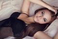 Fashion portrait of beautiful brunette woman on bed sexy girl model Stock Photo