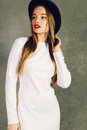 Fashion portrait of beautiful elegant blond woman in white dress and hat Royalty Free Stock Photo