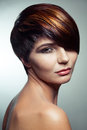 Fashion portrait of a beautiful girl with colored dyed hair, professional short hair coloring.