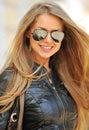 Fashion portrait of beautiful smiling woman wearing sunglasses - Royalty Free Stock Photo