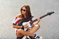 Fashion portrait of beautiful woman with electric guitar Royalty Free Stock Photo