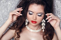 Fashion portrait of beautiful woman with perfect make up over party lights jewelry and beauty Stock Images