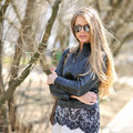 Fashion portrait of a beautiful woman wearing sunglasses outdoors Stock Images