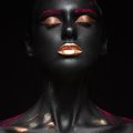 Royalty Free Stock Image Fashion portrait of a dark-skinned girl with color make-up. Beauty face.