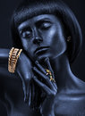Fashion portrait of a dark-skinned girl with jewerly. Black Beau Royalty Free Stock Photo