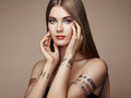 Fashion portrait of elegant woman with magnificent hair blonde girl perfect make up girl in dress flash tattoo gold Stock Image