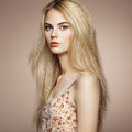 Fashion portrait of elegant woman with magnificent hair blonde girl perfect make up hairstyle Royalty Free Stock Photo