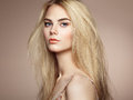 Fashion portrait of elegant woman with magnificent hair blonde girl perfect make up hairstyle Stock Image