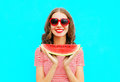 Fashion portrait happy smiling young woman holding slice of watermelon Royalty Free Stock Photo