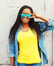 Fashion portrait pretty smiling young african woman in a sunglasses is having fun Royalty Free Stock Photo