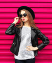 Fashion portrait pretty woman in black rock style over pink Royalty Free Stock Photo