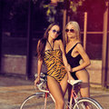 Fashion portrait of two sexy women outdoor outdoors Royalty Free Stock Images