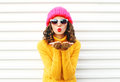 Fashion portrait woman blowing red lips makes sends air kiss Royalty Free Stock Photo