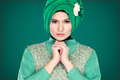 Fashion portrait of young beautiful muslim woman with green cost costume wearing hijab isolated on background Royalty Free Stock Photos