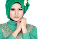 Fashion portrait of young beautiful muslim woman with green cost costume wearing hijab isolated on white background Royalty Free Stock Images