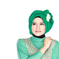 Fashion portrait of young beautiful muslim woman with green cost costume wearing hijab isolated on white background Stock Photography