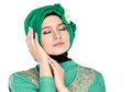 Fashion portrait of young beautiful muslim woman with green cost costume wearing hijab isolated on white background Royalty Free Stock Photo