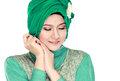 Fashion portrait of young beautiful muslim woman with green cost costume wearing hijab isolated on white background Royalty Free Stock Image