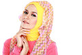 Fashion portrait of young beautiful muslim woman with pink costu costume wearing hijab isolated on white background Stock Image