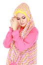 Fashion portrait of young beautiful muslim woman with pink costu costume wearing hijab isolated on white background Stock Photos
