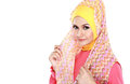 Fashion portrait of young beautiful muslim woman with pink costu costume wearing hijab isolated on white background Royalty Free Stock Images