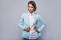Fashion portrait of young elegant woman in azure man jacket Royalty Free Stock Photo