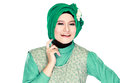 Fashion portrait of young happy beautiful muslim woman with gree green costume wearing hijab isolated on white background Stock Image
