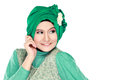 Fashion portrait of young happy beautiful muslim woman with gree green costume wearing hijab isolated on white background Royalty Free Stock Images