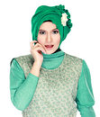 Fashion portrait of young happy beautiful muslim woman with gree green costume wearing hijab isolated on white background Royalty Free Stock Photos
