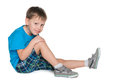 Fashion preschool boy a smiling is sitting on the white background Royalty Free Stock Photos