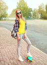Fashion pretty blonde girl with skateboard posing in city Royalty Free Stock Photography