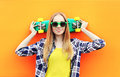 Fashion pretty blonde girl wearing a sunglasses with skateboard Royalty Free Stock Photo
