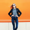 Fashion pretty blonde woman wearing rock black style over orange background Royalty Free Stock Photography