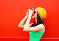 Fashion pretty cool girl wearing colorful clothes with camera Royalty Free Stock Photo