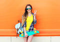 Fashion pretty cool girl wearing a sunglasses, backpack with skateboard having fun Royalty Free Stock Photo