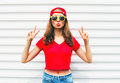 Fashion pretty cool woman in sunglasses and red t-shirt over white Royalty Free Stock Photo