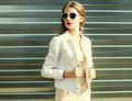 Fashion pretty woman in sunglasses and white denim jacket Royalty Free Stock Photo