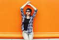 Fashion pretty woman wearing a black sunglasses and shirt over colorful Royalty Free Stock Photo