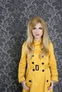 Fashion retro woman yellow gabardine coat Royalty Free Stock Photo