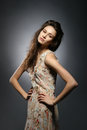 Fashion shoot of a young brunette woman in a dress Stock Image